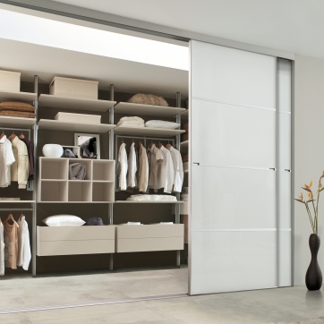 Walk-in wardrobe with Relax linen effect interior.